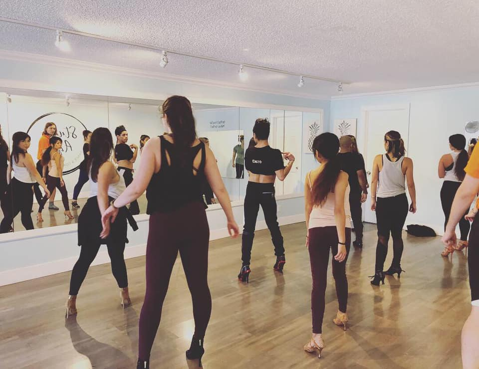 Dance class facing mirror.