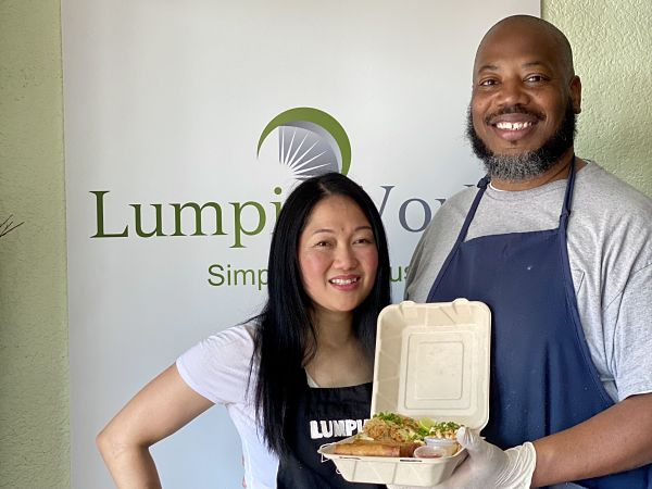 Lumpia World owners Eleanor and Derrick holding lumpia