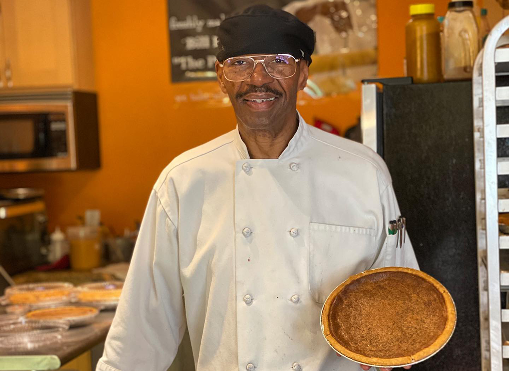 Baked From the Hart owner Bill Hart holding a sweet bean pie inside his business in Seattle, Washington.