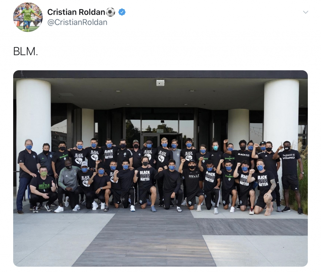 """Tweet by Cristian Roldan that reads """"BLM"""" above a picture of the Seattle Sounders FC team, many of whom are wearing Black Lives Matter t-shirts."""